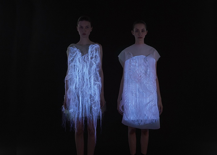 Editorial Use Only. No stock, books, advertising or merchandising without photographer's permission Mandatory Credit: Photo by Dominique Lafond / Rex Features (2595752l) Dress Glowing In The Dark Sensory technology in dress follows your gaze - 27 Jun 2013 VIDEO LINK: http://vimeo.com/68293670 FULL WORDS LINK: http://www.rexfeatures.com/nanolink/lor1 Just look at these dresses and they will begin to move. They are made with photo luminescent thread which glows in the dark and imbedded eye tracking technology which means they respond to a spectators' gaze and activate tiny motors to move parts of the dress in a pattern. Called (No)where and (Now)here, the dresses waft almost like a jellyfish and have been produced by fashion designer Ying Gao who wanted her garments to be more playful and interactive.